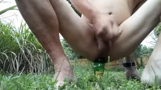 Bottomboyxs bustn a nut outdoors fucking a bottle